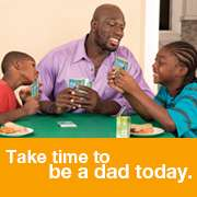 WWE Superstar Titus O'Neil and sons playing cards: Take time to be a dad today -fatherhood.gov